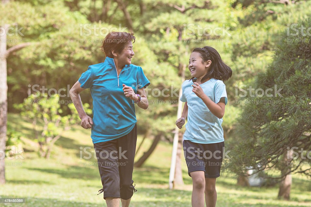 Running with grandmother in Yoyogi park stock photo