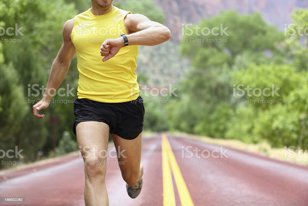 Running with heart rate monitor sports watch stock photo