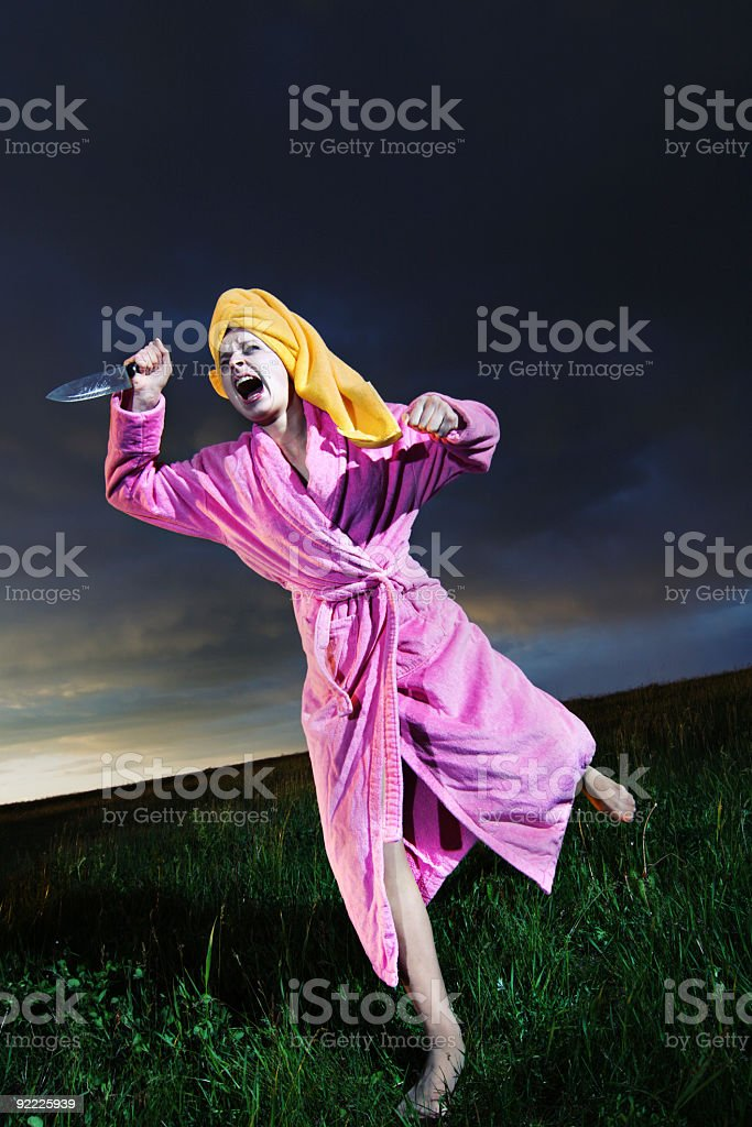 Running Woman with knife royalty-free stock photo