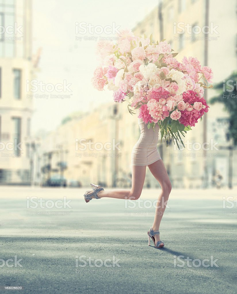 running women with giant bunch of flowers royalty-free stock photo