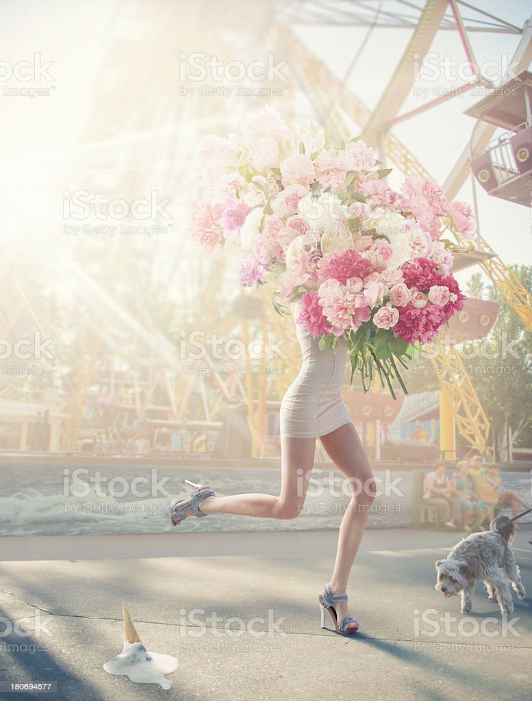 running women with giant bunch of flowers stock photo