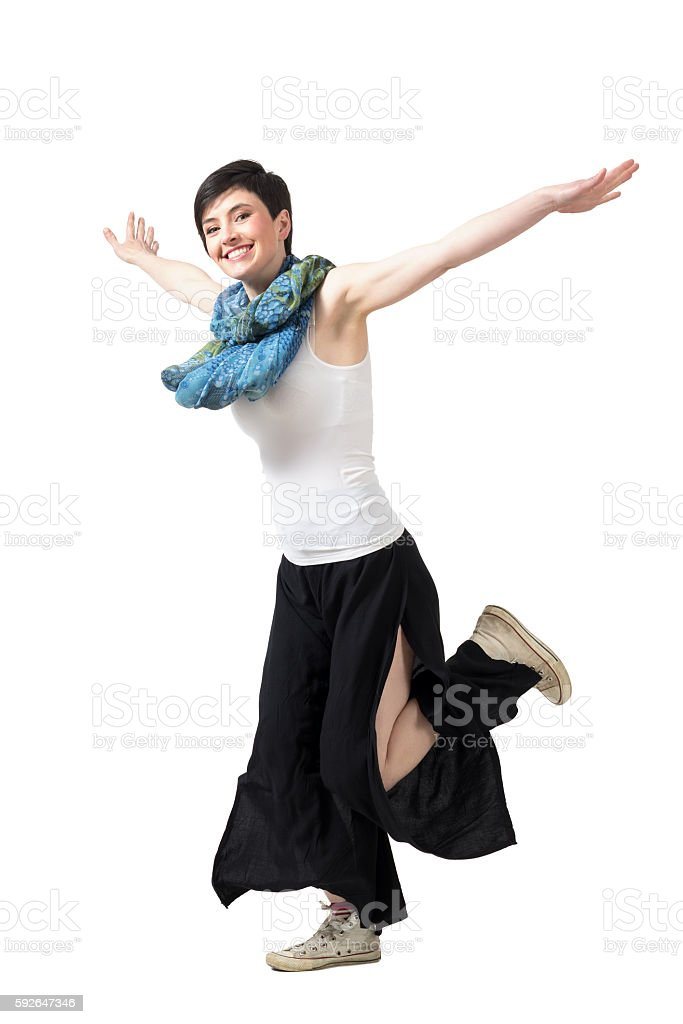 Running young beauty with spread arms smiling at camera stock photo