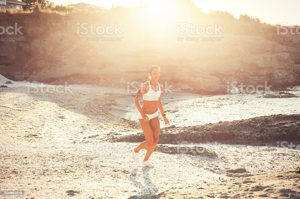 Running young woman stock photo