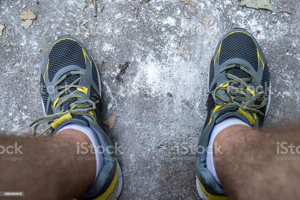 Running/Sport Trainer/Sneaker/Shoe on a Road royalty-free stock photo