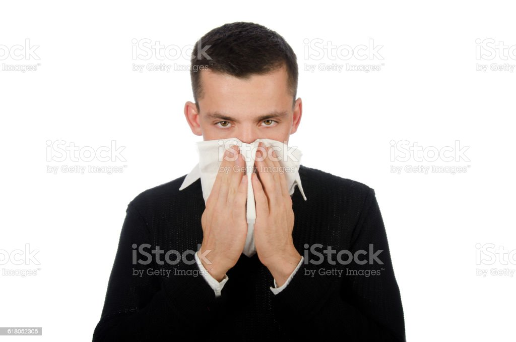 Runny nose. Young man and colds. stock photo