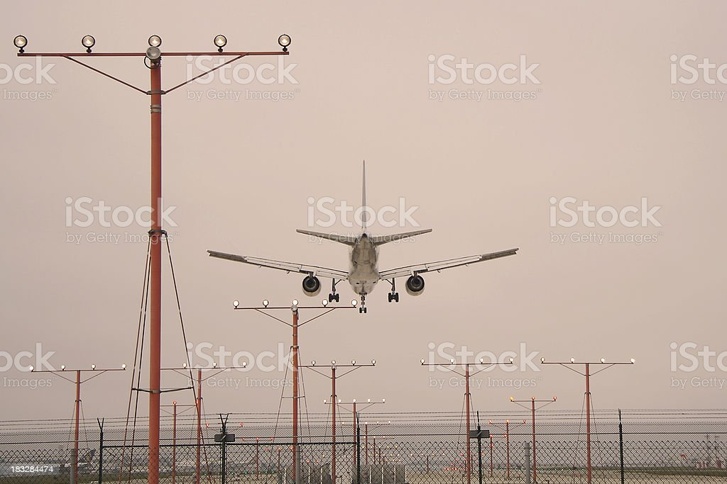runway approach lights and jet landing royalty-free stock photo