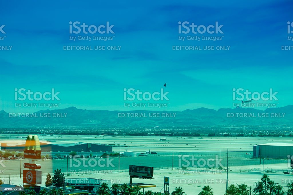 Runway of McCarran airport with airplane and helicopter stock photo