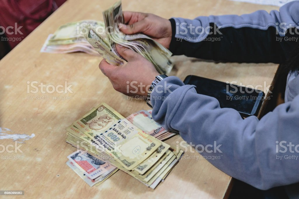 Rupee banknotes for car and guide in Sikkim, India stock photo