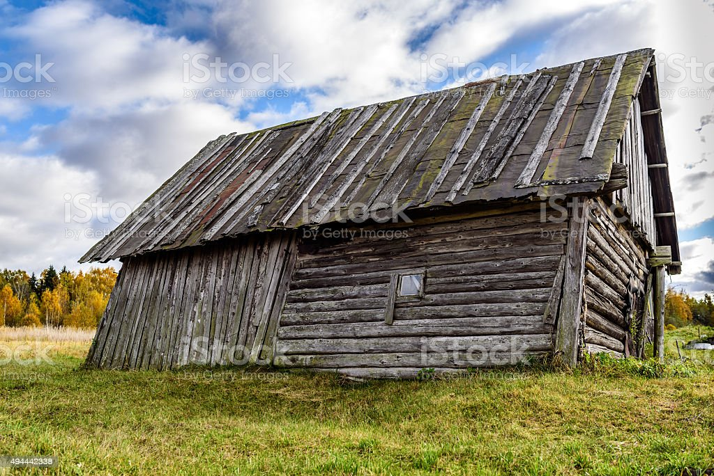 Rural Abandoned Homestead in a rural field in Latvia stock photo