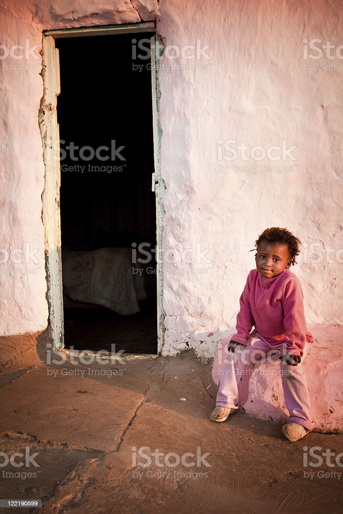 Rural African Girl in Pink stock photo