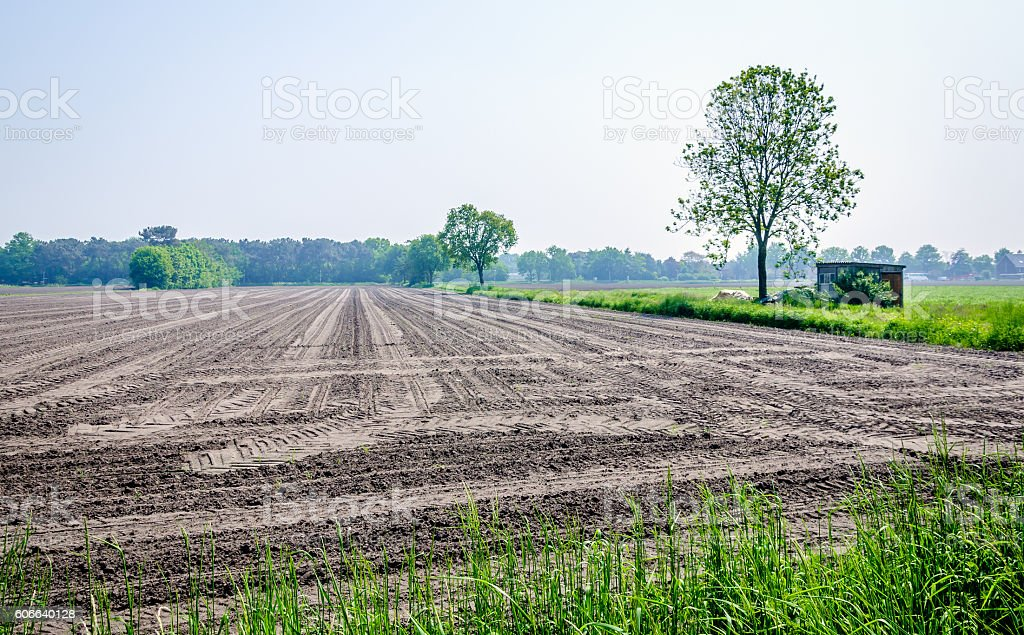 Rural area with a newly machined leveled field stock photo