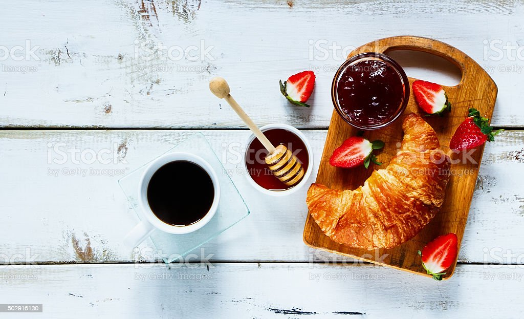 Rural breakfast with croissant stock photo