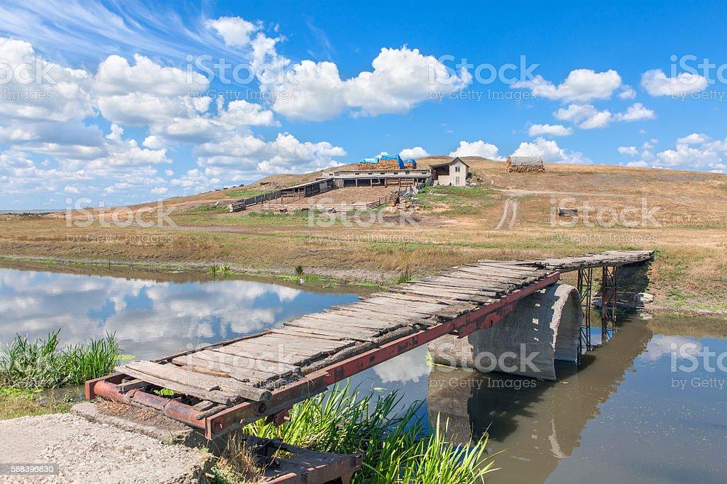 rural bridge over river stock photo