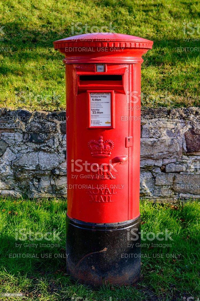 Rural British red traditional Royal Mail pillar box stock photo