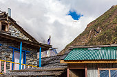 Rural buildings of Mountain Village in Nepal cloudy weather