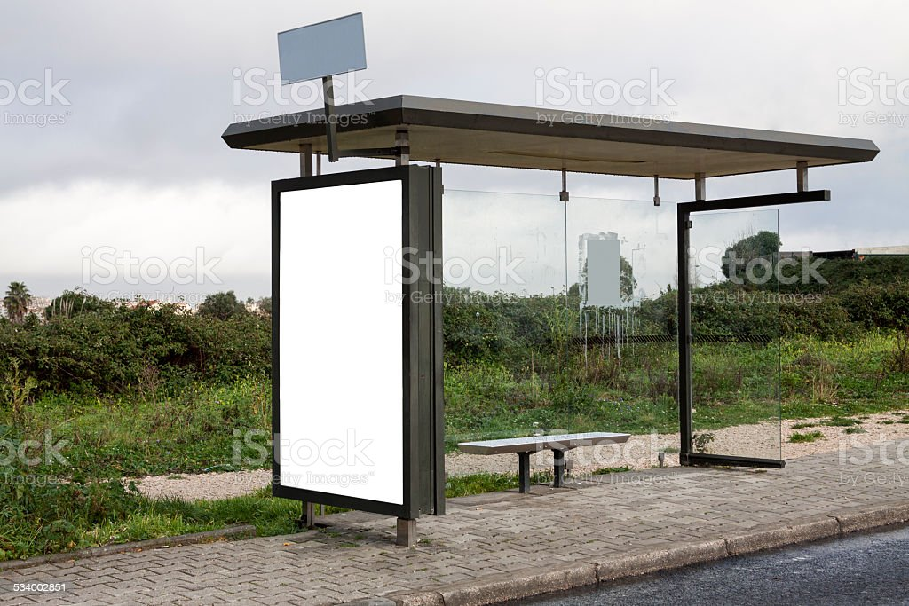 Rural bus stop with blank billboard stock photo
