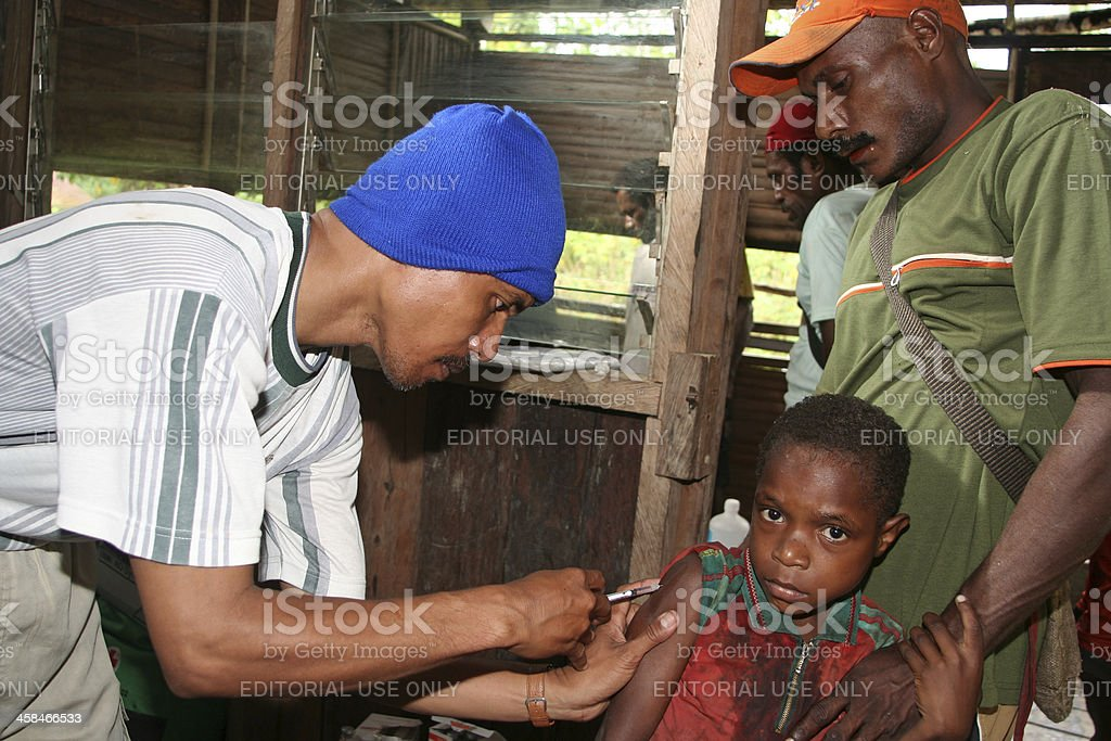 Rural child getting vaccination stock photo