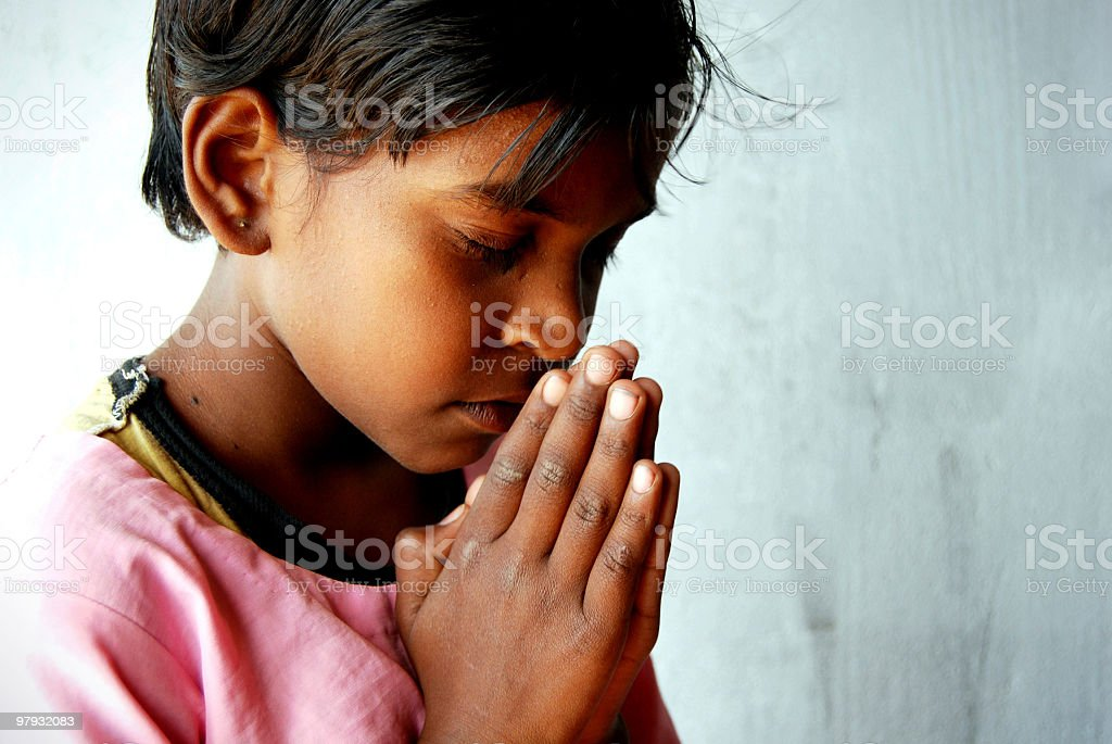Rural child praying stock photo