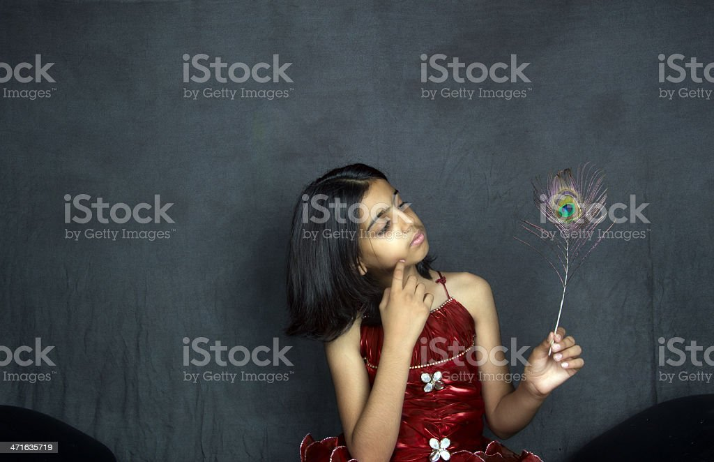 Rural Child with Peacock Feather royalty-free stock photo