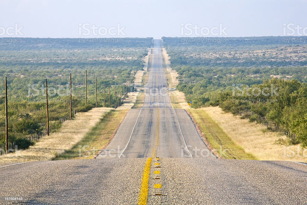 Rural Country Road, Long and Straight, Undulating to the Horizon stock photo