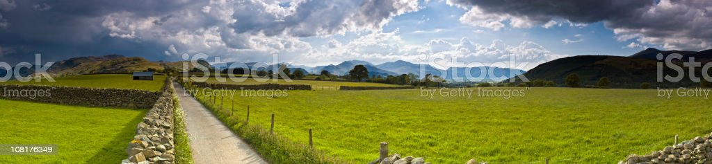 Rural Country Road Near Green Pastures stock photo