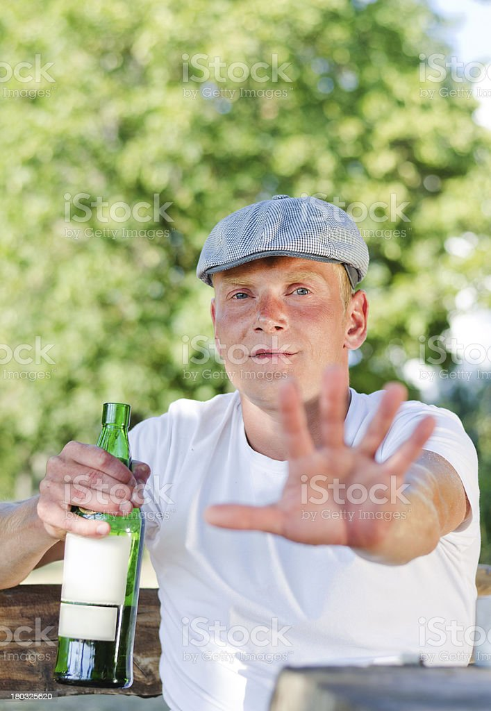 Rural drunk protesting being photographed stock photo
