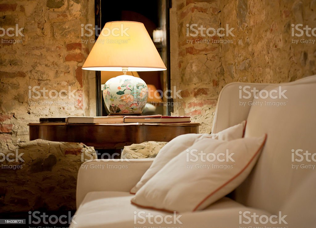 Rural Elegance Lamp And Sofa royalty-free stock photo