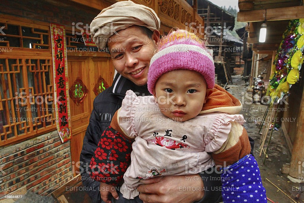 Rural family of Asia, father holding baby in her arms. stock photo