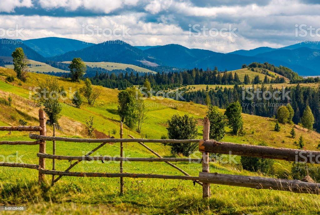 rural fields on hills in mountainous area stock photo