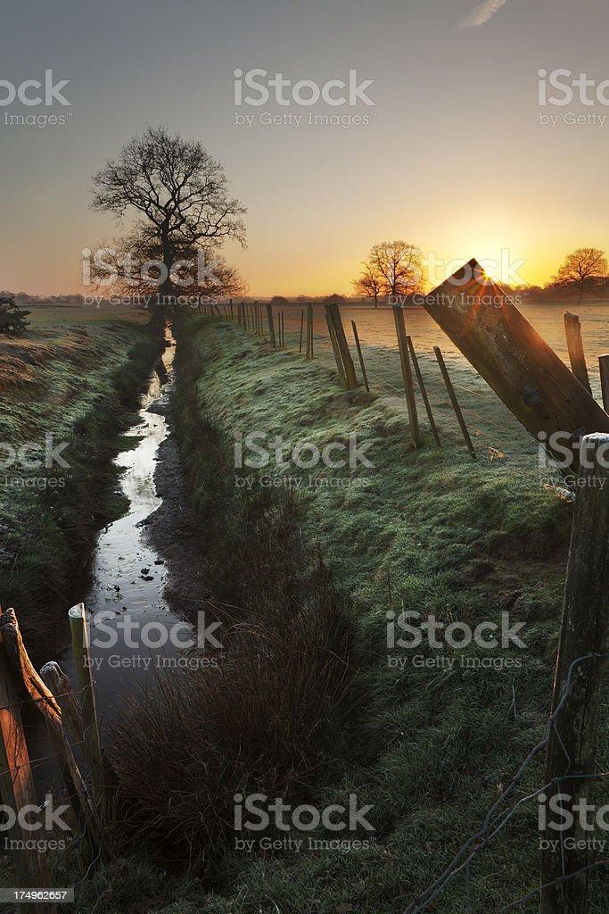 Rural frosty sunrise stock photo