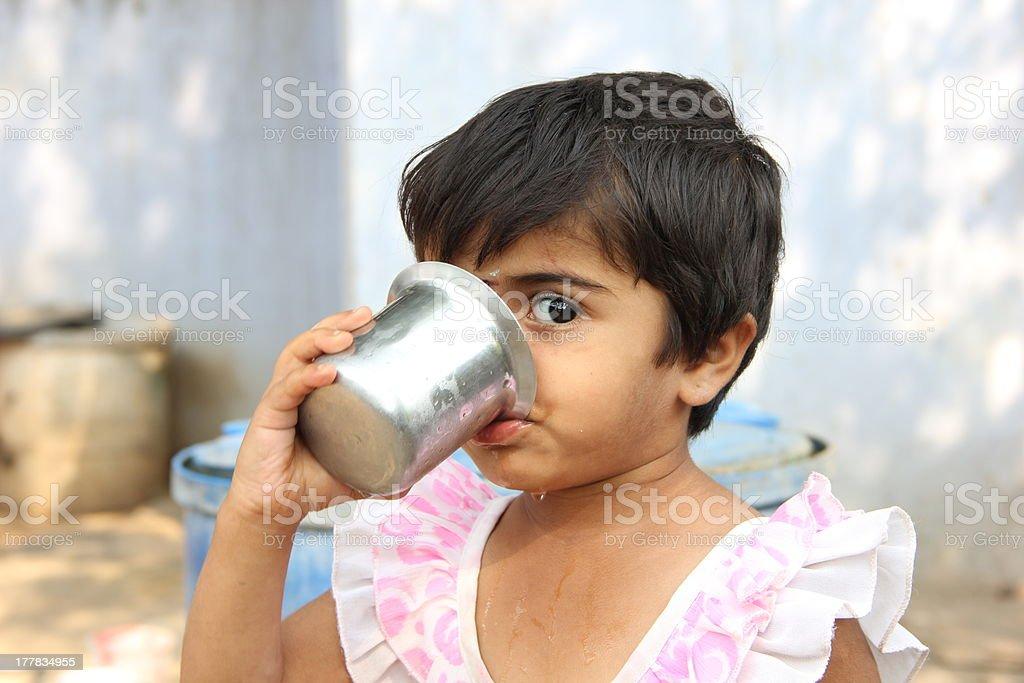 Rural Girl Drinking water stock photo