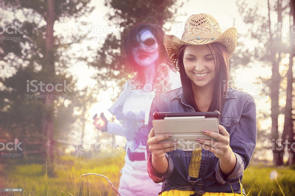 Rural girl reading sci-fi story on tablet royalty-free stock photo