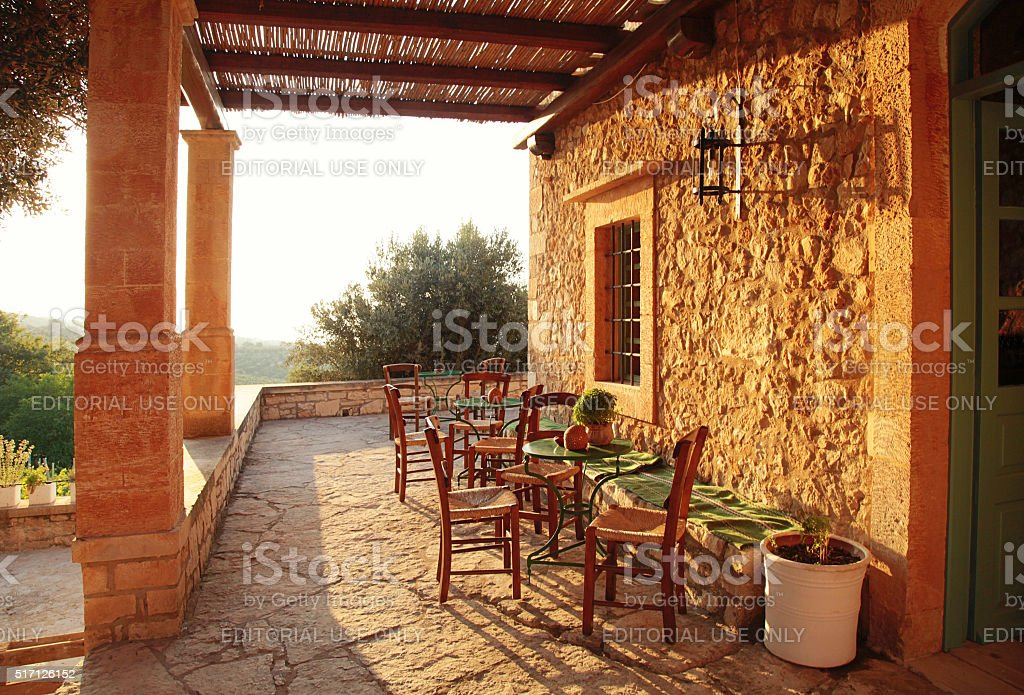 Rural greek country outdoor restaurant on pergola terrace stock photo
