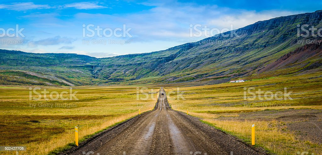 Rural highway car on country road through mountain valley Iceland stock photo