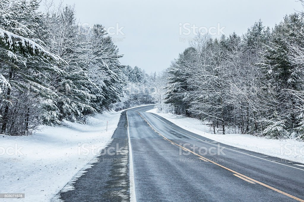 Rural Highway Curve - Adirondacks Winter Blizzard Snow Storm stock photo