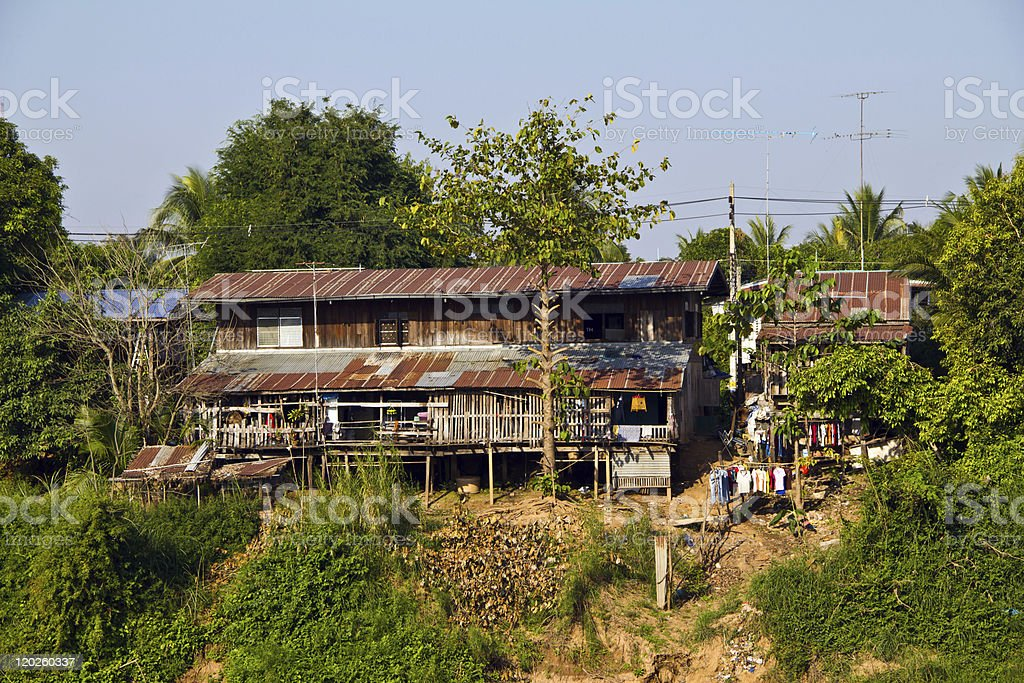 Rural house beside the river royalty-free stock photo