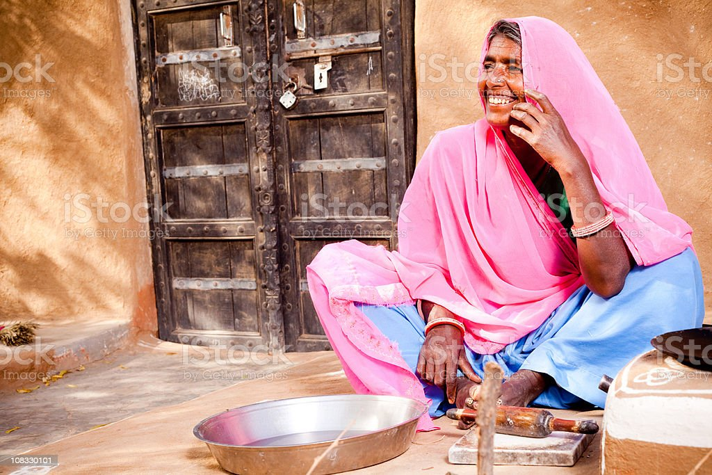 Rural Indian Rajasthani Woman preparing for the food royalty-free stock photo