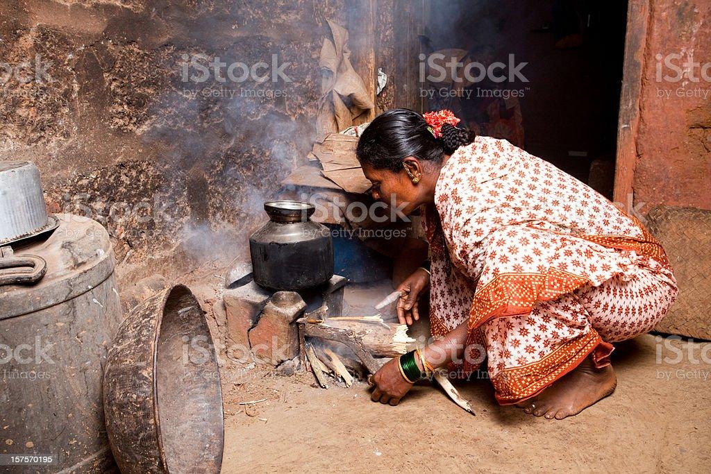 Rural Indian Woman preparing food stock photo