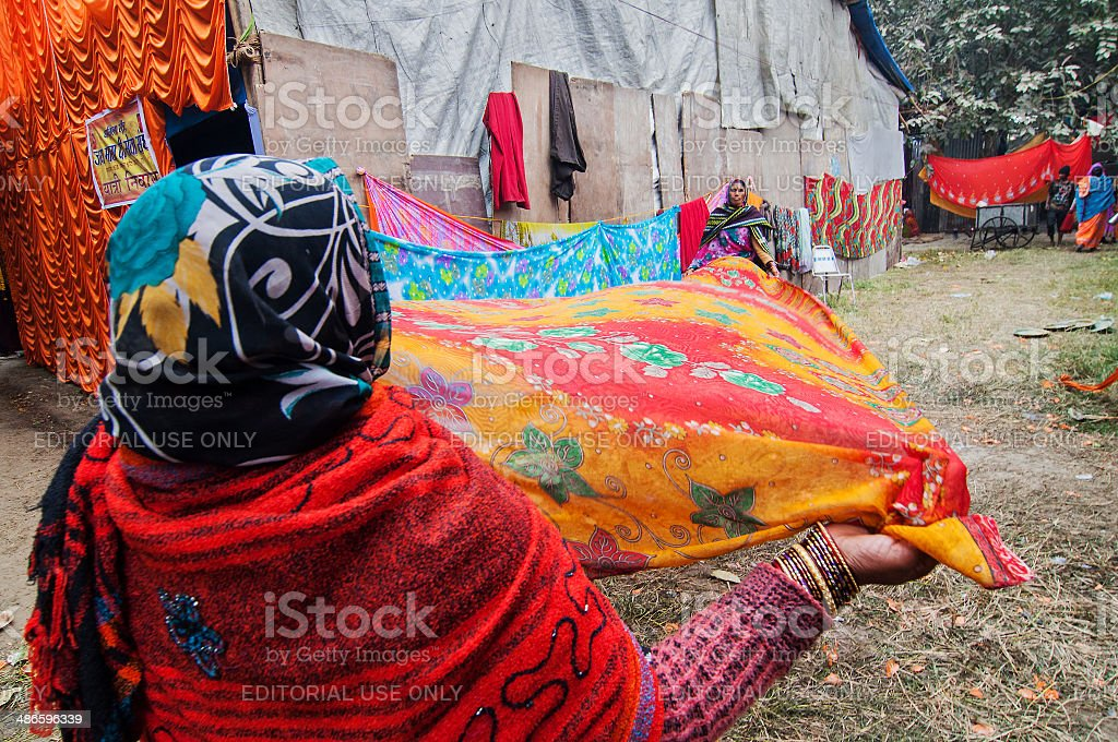 Rural Indian Women drying sari stock photo