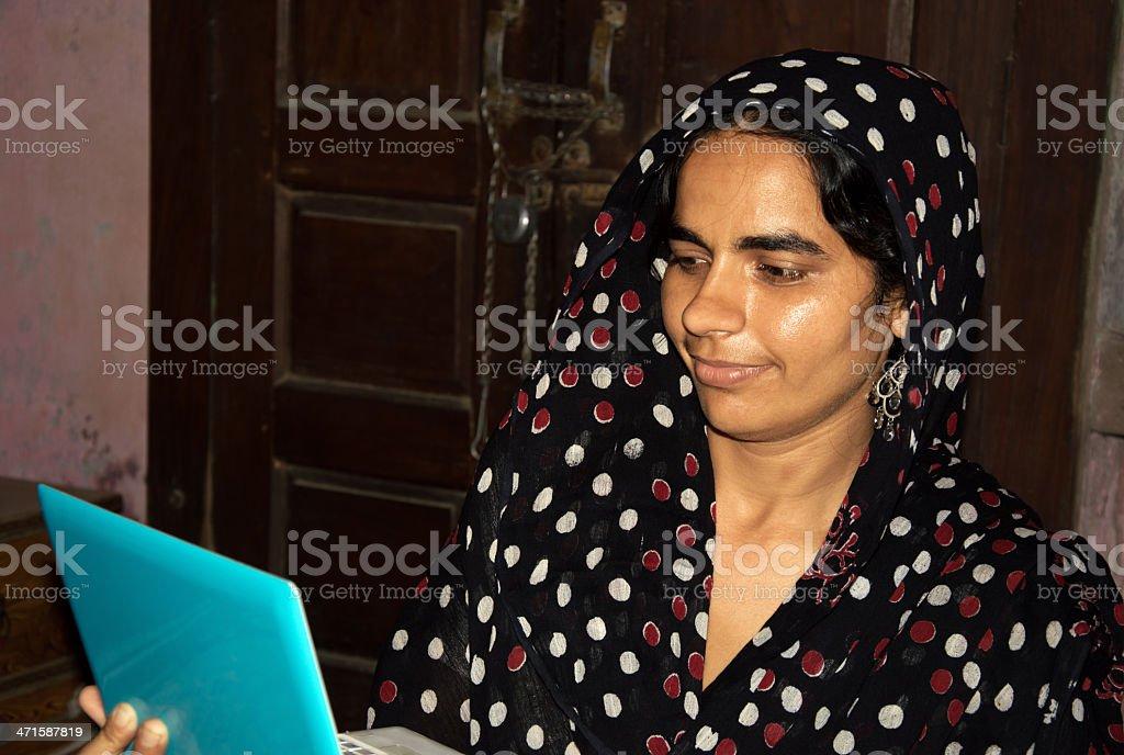 Rural Indian Women Holding Laptop royalty-free stock photo