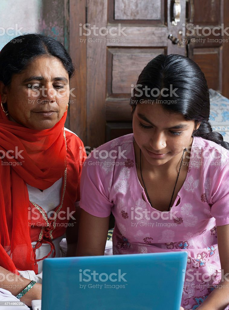 Rural Indian Women Using Laptop with Her Daughter. royalty-free stock photo