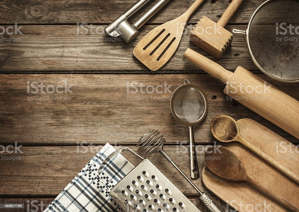 Rural kitchen utensils on vintage planked wood table stock photo