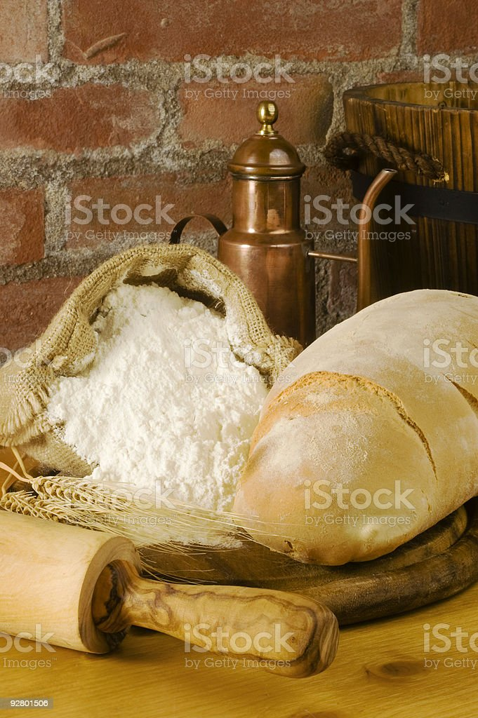 Rural kitchen with bread and flour royalty-free stock photo