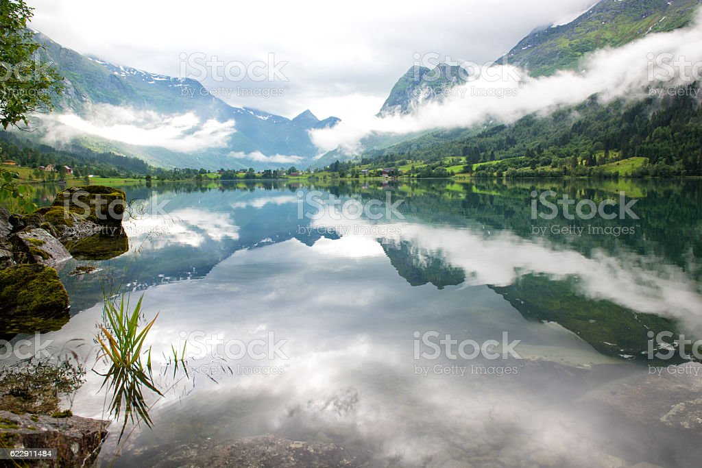 Rural lake landscape with mountains and clouds, Norway stock photo