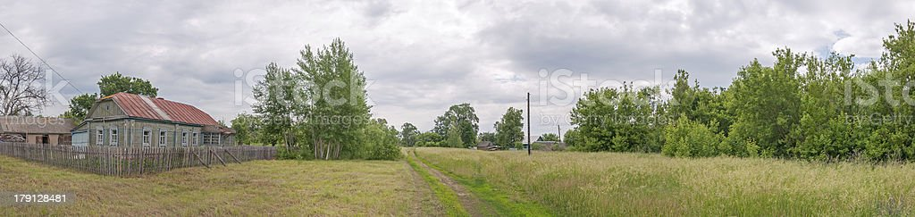 Rural landscape panorama with old wooden house behind picket royalty-free stock photo