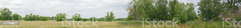 Rural landscape panorama with old wooden houses royalty-free stock photo