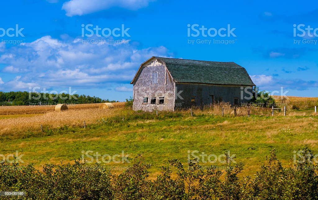 rural landscape with a barn stock photo