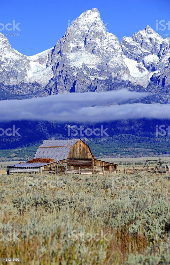 Rural landscape with alpine background and snow capped peaks, Wyoming stock photo