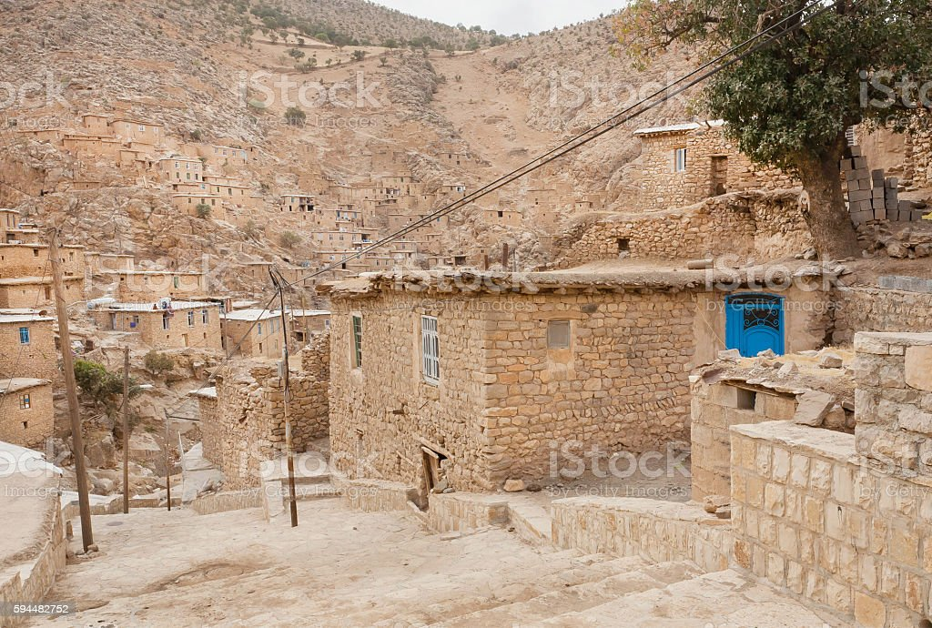 Rural landscape with brick houses in mountain village Palangan, Iran stock photo