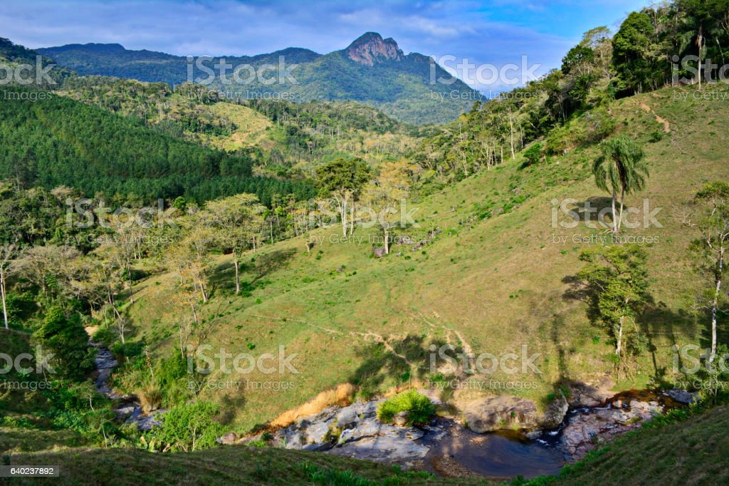 rural landscape with river and mountain stock photo